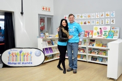 Our MD and his wife standing with some of the R10000 worth of books we gave to the 3 schools.